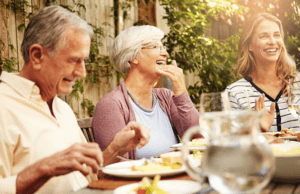 happy elderly people eating dietary protein